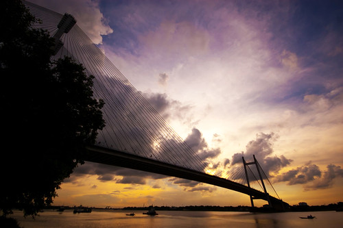 travel bridge sunset sky india history tourism silhouette architecture clouds river landscape boats construction ancient nikon pov perspective sigma wideangle landmark hues kolkata ganga historiccity ganges westbengal hoogly cwc sigma1020mm travelphotography hooghly hooghlyriver princepghat vidyasagarsetu nikond40 hooglyriver silhouettephotography hooglybridge kalspics chennaiweelendclickers