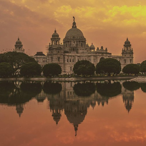 instagramapp square squareformat iphoneography uploaded:by=instagram casualphotography indianplaces indianphotography sunsets sunset sunsetsky building reflection orangesky colorful buetiful nikon nikonphotography nikontop nikond3200 nikkor kolkata india victoria memorial