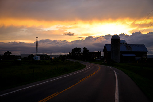 "road county sunset sun white green wet lines rain yellow night barn rural pavement farm farmland silo foliage americana winding lush backroad goldenhour agricultural sunbeams williamshakespeare montgomerycounty mindenville stateroute5s ""lovecomfortethlikesunshineafterrain"""