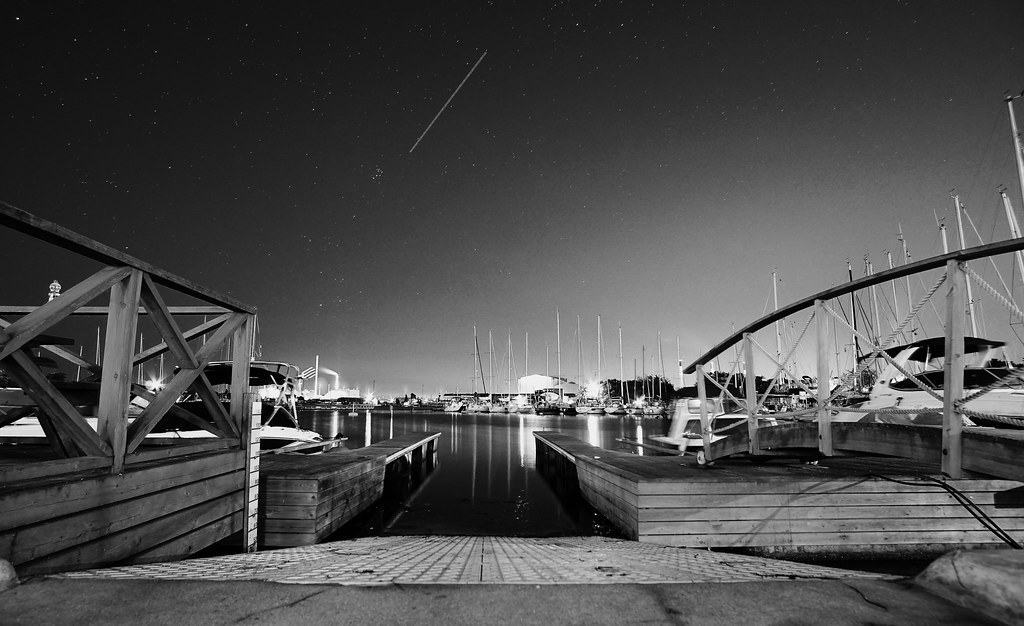 Midnight harbour with shooting...