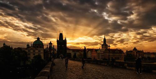 prague charles bridge sunrise city warmtones