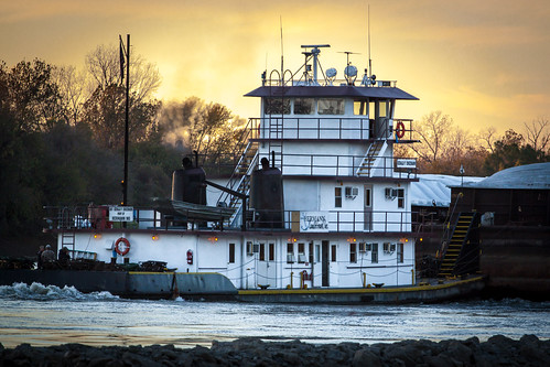 tow boat towboat missouri mo river hermann sand gravel sunset evening fall autumn barge jetty