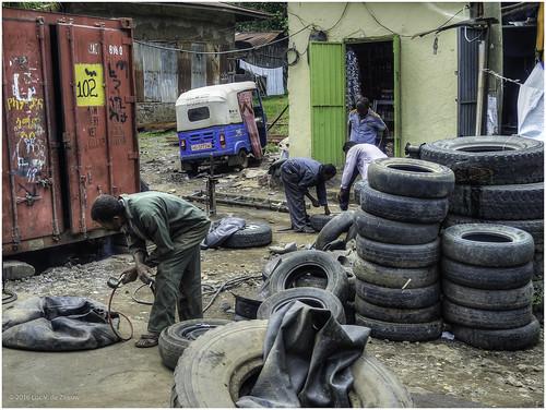 air container employee ethiopia man repair street tire tube tuktuk workshop weldiya amhara
