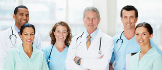 Group of doctors smiling against blur background | by Salutaria