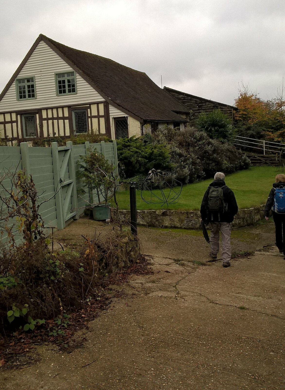 Walkers pass a house in Sussex