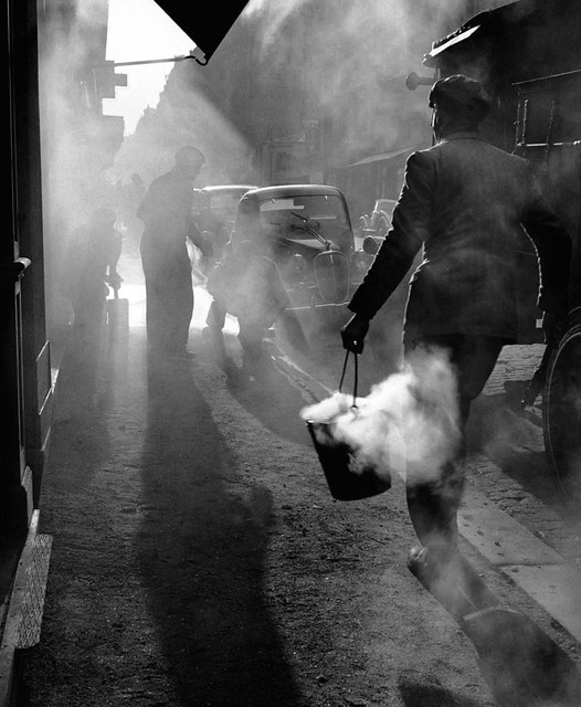 Through the smoke in the early morning foggy light // By Edouard Boubat