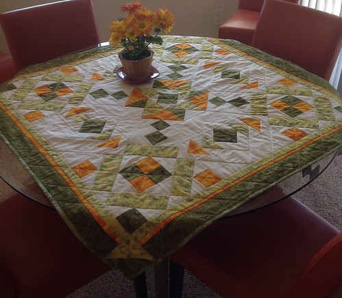 Desert Bloom Quilting Christmas BOM, pieced fall of 2015, quilted this week and on my table for autumn color - the maple leaves and pumpkins runner from Autumn Jubilee is gracing my daughter's table. 😄