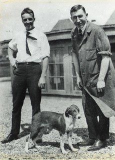 Photograph of F.G. Banting and C.H. Best with a dog on the roof of the Medical Building | by Thomas Fisher Rare Book Library, UofT