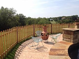 Cedar picket fence.  Unstained with black iron posts.  Weatherford, Texas | by buzzcustomfence