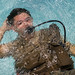 A U.S. Air Force survival, evasion, resistance and escape trainee uses a small oxygen tank to breathe underwater while upside down to help students to learn to control their breathing during a water survival portion of SERE training at Fairchild Air Force Base, Wash. SERE students conduct two days of water survival training to prepare them for underwater egress. (U.S. Air Force photo/Tech. Sgt. Bennie J. Davis III)