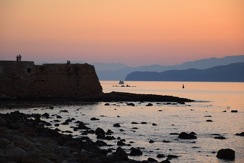 sunset sea water calm peaceful island hill layers weather air fortezza old historical harbour chaniavenetianharbour landscape seascape mediterranean nature view people silhouettes evening colours sky rocks stones building wall chania hania xania canea crete kriti kreta greece summer