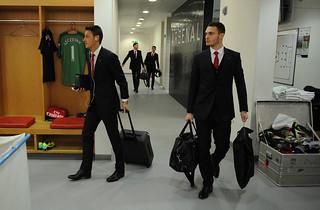 Mesut Ozil and Thomas Vermaelen of Arsenal
