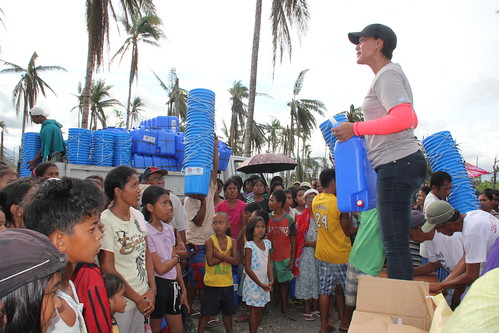 Distributing buckets and jerrycans in Santo Nino, Leyte | by DFID - UK Department for International Development
