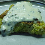 Leek, sprouts and onion egg cake with hazelnut dressing