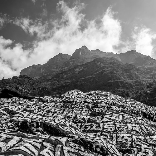 nepal blackandwhite mountain mountains birds rock clouds landscape hiking buddhist canadian hike holy mountaineering peaks khumbu carvings hights mantras d7000