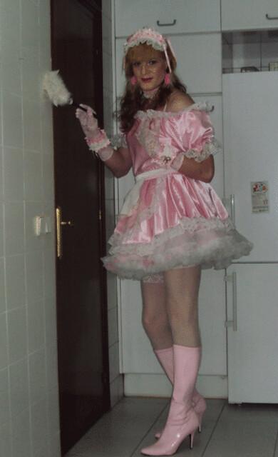 246. Sissy maid in pink dusting