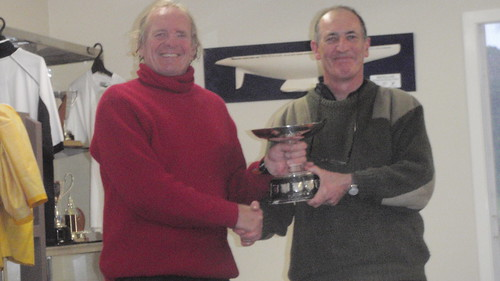 Ian Wallace receiving from Commodore Will Perry the Kaiahiku Trophy for most wins in the season | by PLSC (Panmure Lagoon Sailing Club)