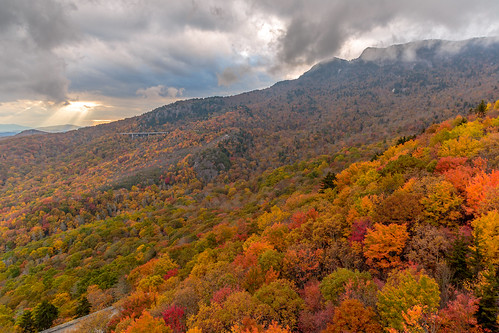 autumn sunset storm fall leaves clouds day cloudy northcarolina autumncolors boone sunbeam blueridgeparkway blueridge grandfathermountain roughridge linncoveviaduct pwfall