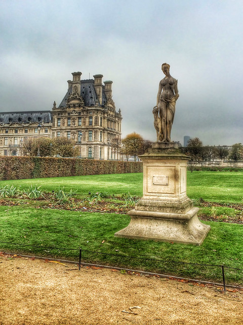 Statue and the Louvre in Paris, France