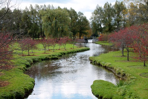 bridge trees red green fall water stone stream lazy crooked meandering pituresque tended