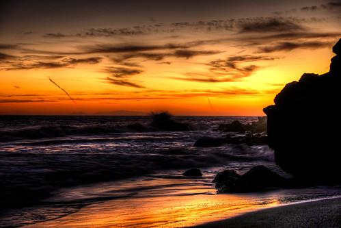 ocean sunset sea sky orange sun reflection beautiful yellow rock clouds contrast sunrise twilight sand rocks pretty waves glow bank shore reflective