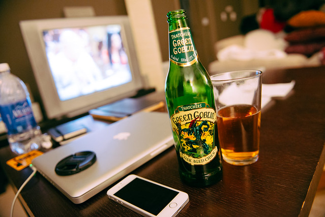 Enjoying some hard cider before doing some late-night work.