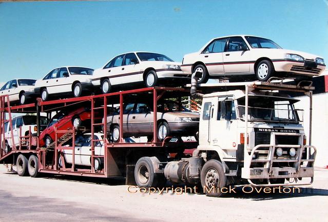Brand new Holden Commodores + 1 Camira (Aussie J car) Queensland 1988 haul by Nissan truck 195PAQ