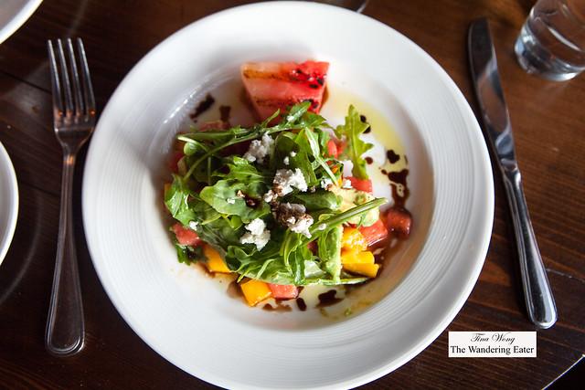 Grilled watermelon salad, avocado, mango, arugula, and goat cheese
