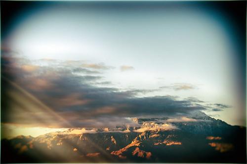 california sky usa mountain snow rain clouds sunrise vintage landscape early nikon view earlymorning lightleak coachellavalley lensflare sunburst d200 liquid vignette hdr goldenhour deserthotsprings odc hss riversidecounty flickrfriday sanjacintomountain onthesunnyside niksoftware twittertuesday sliderssunday hbmike2000 analogefex
