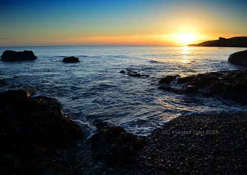 ireland sea sky irish black castle beach sunrise coast town nikon rocks waves stones tide silhouettes wicklow countywicklow d5100