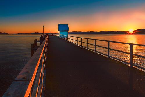 citylandscape coastallandscape evening foreshore huttcity landscape lowerhutt nature newzealand northisland petone pier seascape sunrays sunset sunshine vanishingpoint wellington cityscape nz