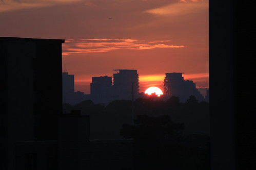 city sunset red urban sun toronto canada art water buildings cntower cityhall flags
