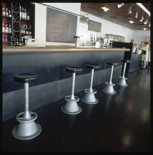 Brass counter and barstools at Café Kiasma   by Museum of Contemporary Art Kiasma