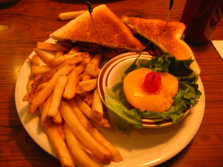 BLT with fries and a peach half