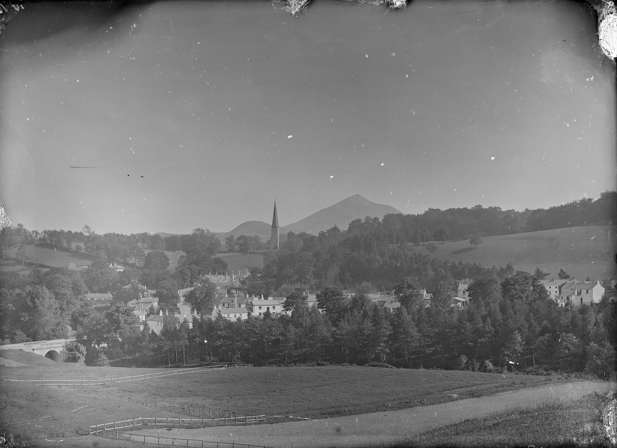 Town or village with church tower visible in the distance... is Enniskerry, Co Wicklow