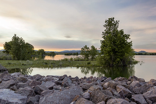 trees water grass clouds sunrise reflections rocks day cloudy