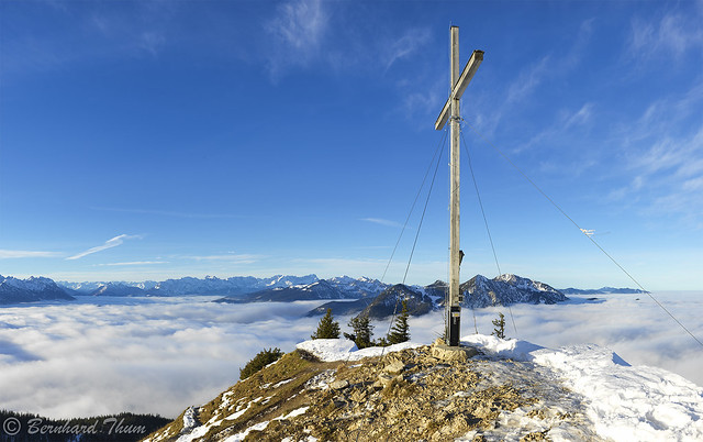 Summit of Jochberg over a sea of clouds