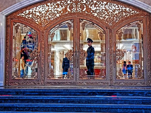 life street blue people stairs reflections mall shopping gold glasses escalator vietnam hanoi doorman