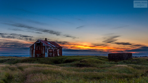 old blue roof sunset sky cloud sun house green grass yellow metal rural iceland rust ruins iron straumsvik