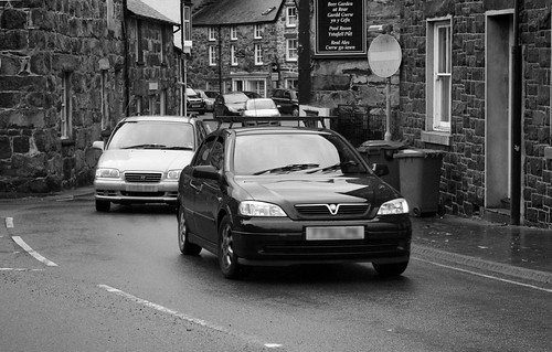 Vehicles wend their way through town | by Helen in Wales