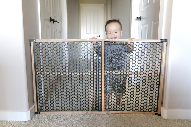 Safety 1st bamboo baby gate in living room
