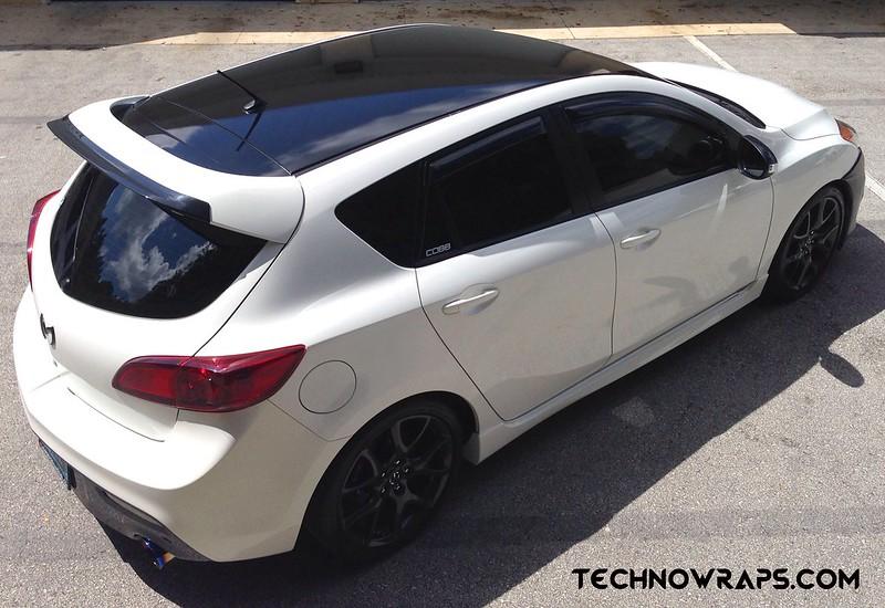 Glossy black car roof wrap on Mazda 3