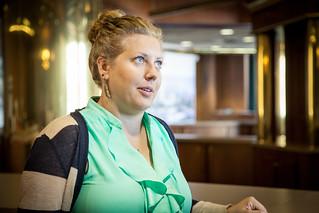 CU Woman Listening in Lobby   by VBuckley.com