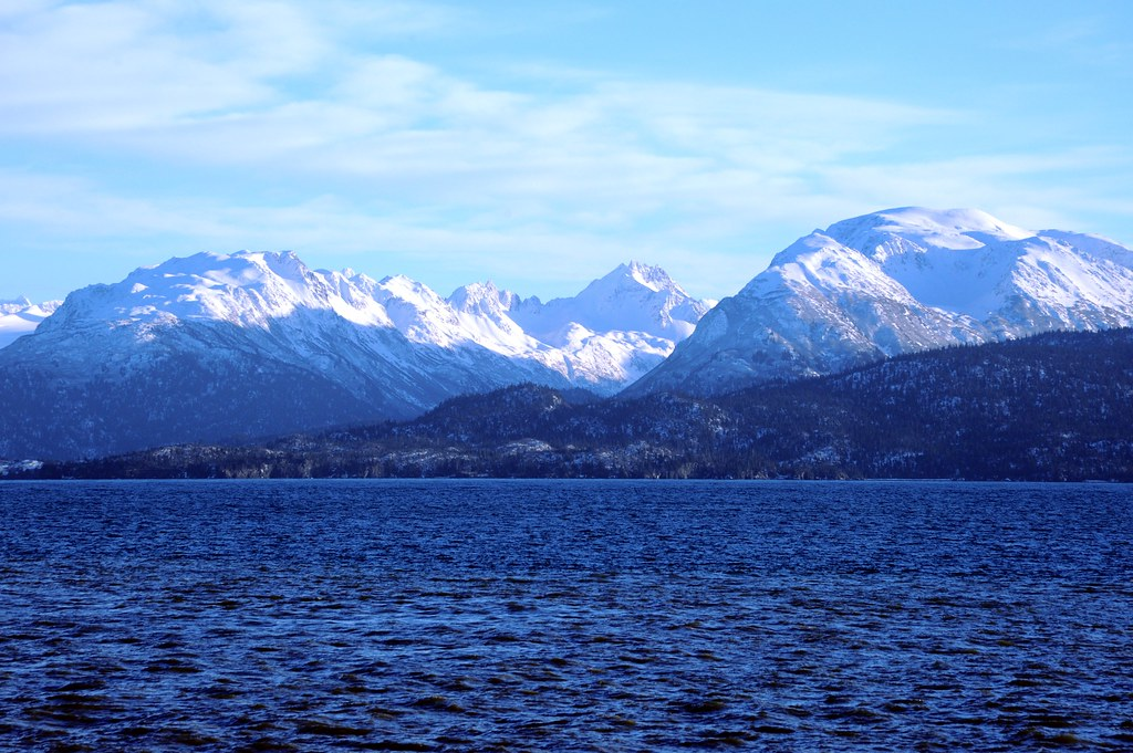 Snowy mountains and glaciers, valleys overlooking Katchemak Bay, beautiful clear winters day, from the end of Homer Spit, Homer, Alaska, USA
