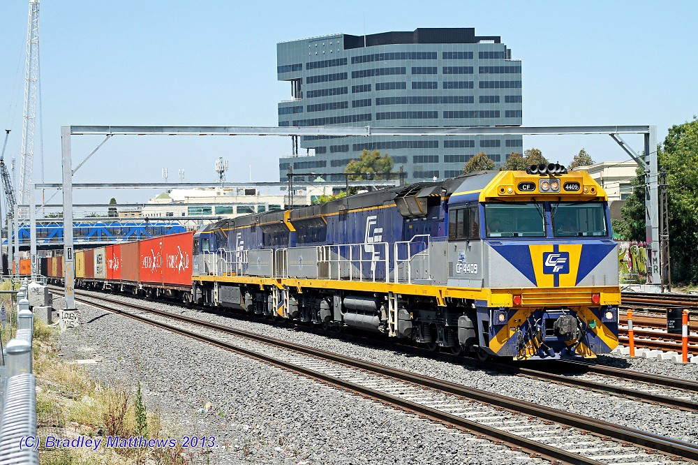 CF4409-CF4410 with QUBE 3MC1 freight to Harefield/Junee at Footscray (17/12/2013) by Bradley Matthews