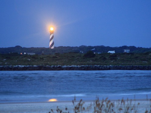 blue lighthouse white black reflection sunrise coast sand florida coastline grasses staugustine channel striped eastcoast circularstaircase dawnlight lightflare beachhouses 1874 amazingview staugustinelighthouse northernflorida seainlet 219steps overtreecanopy 8thtallestlighthouseintheus 163feet