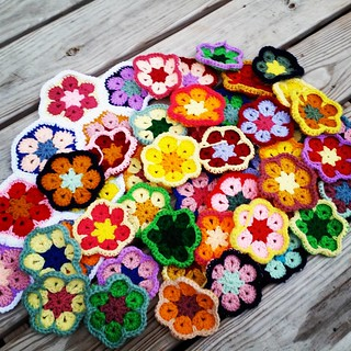 I feel like my pile looks so small, but I've got 48 #africanflower so far! Only 8 are stitched together so far. I'm loving the progress of this #crochet project though.