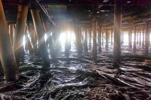 california water pier waves santamonica pacificocean santamonicapier sunrays pylons sunbeams underthesantamonicapier waterpictorial joelach