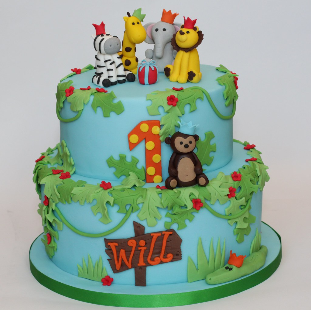 Groovy Jungle Birthday A 2 Tier Jungle Themed First Birthday Cake Flickr Personalised Birthday Cards Bromeletsinfo