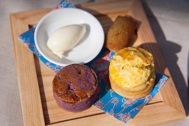 """Scones """"tier"""" - Okinawa purple potato scone, tumeric scone, tea financier and clotted cream"""